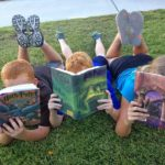 Picture of three primary-aged children reading