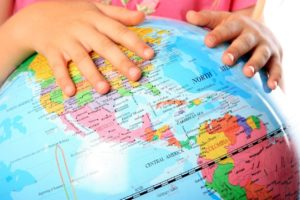 Picture of a child's hands on a globe